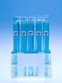 Bio hazardous substance in laboratory test tubes — Stock Photo