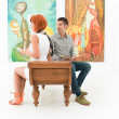 Stock Photo: Couple admiring artworks