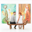 Happy couple in art gallery — Stock Photo