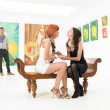 Stock Photo: Two best friends in art gallery