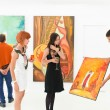 Art collectors at exhibition opening — Stock Photo