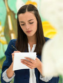 Young female student in an art gallery — Stock Photo