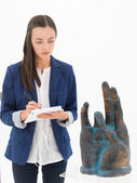 Taking notes about some artworks in a museum — Stock Photo