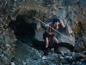 Cavewoman hunting with spear — Stock Photo