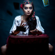 A portrait of a gypsy fortune teller throwing the tarot cards. — Stock Photo #4931015