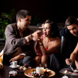 Young couples having deserts and coffee — Stock Photo #6277276