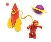 橡皮泥火箭和太空中的宇航员. — 图库照片