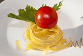 Fettuccine with tomato and parsley. — Stockfoto