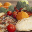 Pizza and vegetables — Stockfoto