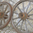 An old wooden wheel - Stock Photo