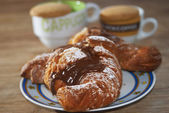 Croissant with chocolate — Stock Photo