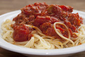 Pasta with tomato juice and tuna — Stock Photo