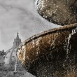 Stock Photo: Bernini's fountain at St peter square in Rome