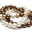 Bracelet of brown, yellow and white pearls. — Stock Photo #39125319