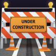 Under Construction traffic barricade - Stock Photo