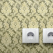 Electric outlets on wall - Stock Photo