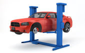 Car lifted up on lift — Stock Photo