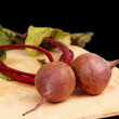 Stockfoto: Young beets with leaves on board.