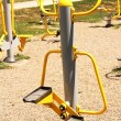 Playground in a city park. Fitness equipment available. - Stock Photo