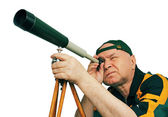Man, an astronomer looking through a telescope. — Stock Photo