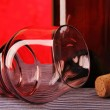 Bottle, wine glass, cork. Colored background. — Stock Photo #13905585