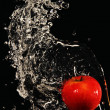 Apple doused with water - Stock Photo