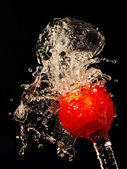 Apple under running water — Stock Photo