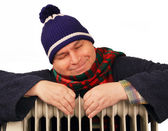 Man basking in the heater. — Stock Photo