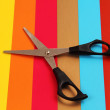 Scissors on colored cardboard. - Stock Photo