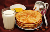 Pancakes with milk. — Stock Photo