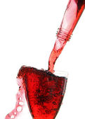 Stream of wine from the bottle into the glass. — Stock Photo