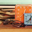 Alarm clock and books. - Stock Photo