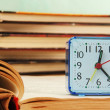 Stock Photo: Alarm clock and books.