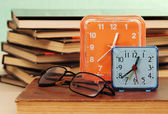 Alarm clock and books. — Stock Photo