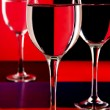 Wine glasses on a colored background. — Stock Photo
