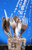 Cutlery under running water. — Stock Photo