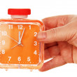 Stock Photo: Orange alarm clock in hand on white background.