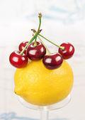 Lemon and cherry. — Stock Photo