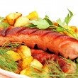 Grilled sausage with garnish on the plate. — Stock Photo #26841029