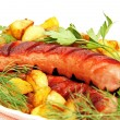 Grilled sausage with garnish on the plate. — Stock Photo