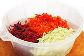 Shredded beets, carrots and onions. — Stock Photo