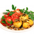 Stock Photo: Roasted potatoes with tomatoes.
