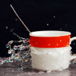 Teacup in a spray of water. — 图库照片