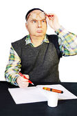 Man in traditional cap is studying the document. — Stock Photo