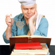 Chef with recipe book. — Stock Photo