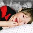 Little boy lying on the pillow. — Stock Photo