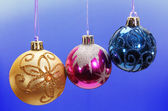 Three colored Christmas balls. — Stock Photo