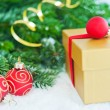 Gift with Christmas tree and balls — Stock Photo #16029983
