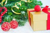 Gift with Christmas tree and balls — Stock Photo