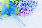 Gift with a blue ribbon — Stock Photo